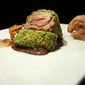 Pork fillet black nebrodi cooked at low temperature in a pistachio crust and hazelnut flavored with black truffle pasta sauce mara in Modica
