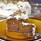 Carrot Pecan Cake with Cream Cheese Frosting; grating v shredding