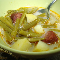 Green string beans with potatoes and smoked sausage