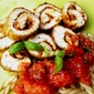 Turkey rolls with pesto and tomato sauce
