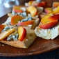 07.06.13: appetizer (garlic-rubbed crostini with peaches, Gorgonzola piccante, and honey)