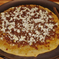 Caramelized Onion Sausage and Goat Cheese Pizza