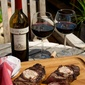 Pecan Planked New York Strip Steak with Red Wine Compound Butter