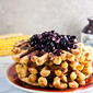 Sweet Corn Waffles with Blueberry-Bourbon Sauce