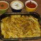 Baked potatoes with three sauces