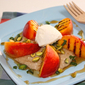 Grilled peaches on coconut rice cream and pistachios