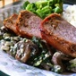 Bacon Wrapped Pork Loin with Goat Cheese, Mushrooms and Spinach