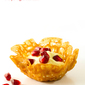 Brandy snap baskets with chantilly cream and pomegranate seeds