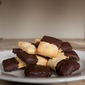 The Last Indulgence: Chocolate Dipped Hazelnut Cookies.