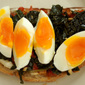 Hearty Braised Kale, Roasted Tomato and Egg Breakfast Sandwich