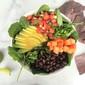power greens, papaya, and black bean taco salad bowl
