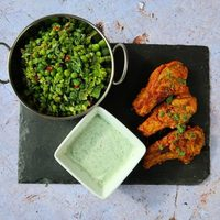 Lamb Tikka Cutlets With Smashed Peas with Spring Onions & Chilli
