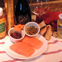 Alder Hot Smoked Salmon with Pistachio and Dried Cranberry Crust and Orange Chipotle Vinaigrette