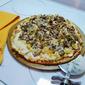 Chicken, bacon, mushroom & artichoke pizza