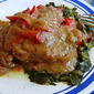 Smothered Pork Chops over Collard Greens