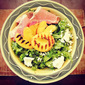 Kale & Grilled Peach Salad with Goat Cheese & Prosciutto in a Pomegranate Vinaigrette