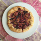 Plum galette with ginger ricotta filling