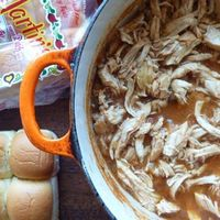 pulled chicken with pickled onions and coleslaw