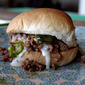 Chipotle Sloppy Joe Sliders with Havarti Cheese Sauce and Caramelized Jalapenos