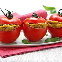 Tomato filled with sardines in olive oil.