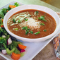 Creamy Tomato Soup with Cherry Tomatoes and Salty Parmesan Cheese
