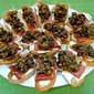 Cream Cheese Crostini with Prosciutto and Tapenade