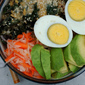 The World's Best Rice Bowl with Tahini-Ginger Kale, Avocado, Egg & Pickled Daikon