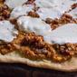 Pizza night: pesto Trapanese pizza with mozzarella and sausage.