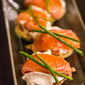 Alex Stupak's mezcal-cured salmon with savory cream cheese foam and Ina Garten's blinis.