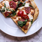 Pizza with roasted tomato-garlic-herb passata and fresh mozzarella