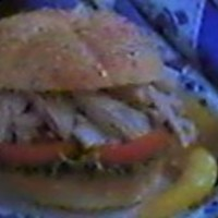 Shredded Chicken On a Sesame Roll with Lettuce & Tomatoes