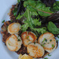 Caramelized scallops with smoked chili cream, mixed greens and potato scallion pancakes