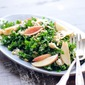 kale apple bacon and bleu cheese salad in a spicy mustard vinaigrette