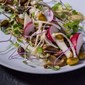 Pan-roasted mushroom salad with pickled sunchokes and braised pistachios from Momofuku.