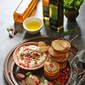 Polenta Cheese Crackers and a cracker of an Eggplant Melon Seed Dip … with infused olive oils