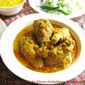 Narkel Kanchalonka Doi diye Chicken / Chicken cooked with coconut, green chillies and curd