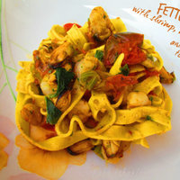 Fettuccine with shrimp, mussels and cherry tomatoes