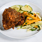 Alton Brown's The General's Fried Chicken with Michael's hot sauce pickles and green papaya and mango slaw.
